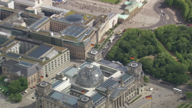 ws aerial zi view of reichstag building and people near river with road way / germany - cupola video stock e b–roll