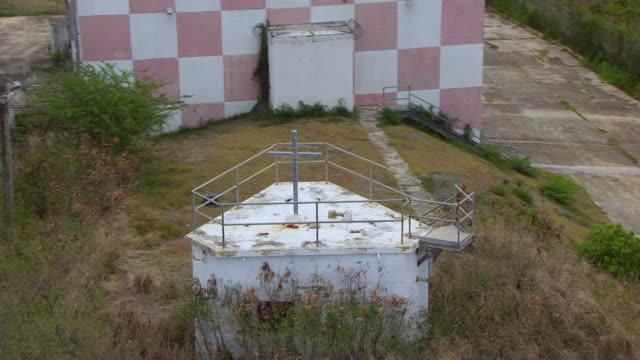WS AERIAL POV View of religious cross near Navy Training Range Building / Vieques, Puerto Rico, United States
