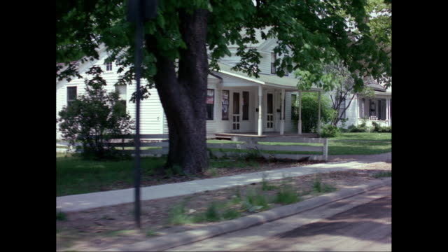 ws pov view of residential area, 1964 chevrolet car outside residential building / united states - porch stock videos & royalty-free footage
