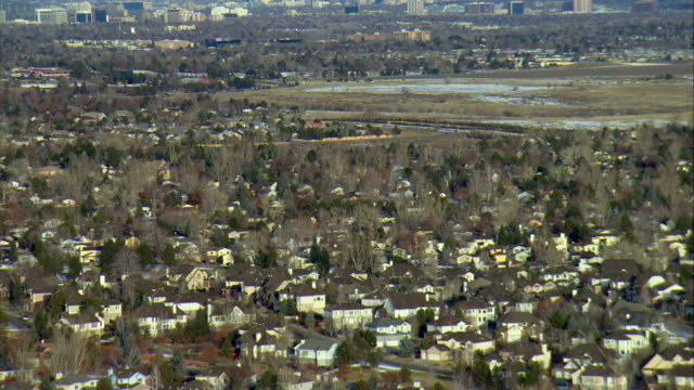 ws tu view of residential area with downtown denver skyline and rocky mountains / denver, colorado, usa - colorado stock videos and b-roll footage