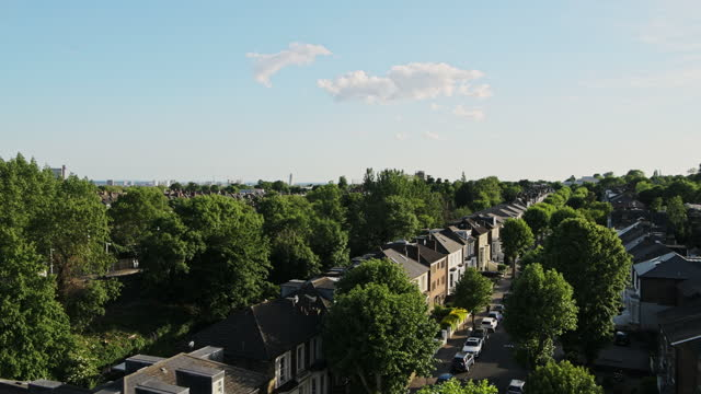 view of residential terraced housing in central north london, uk with lush trees in the surrounding - high angle panning shot - north stock videos & royalty-free footage