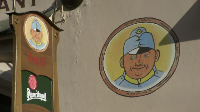 ms view of restaurant sign and picture on wall / prague, hlavni mesto praha, czech republic - figura maschile video stock e b–roll