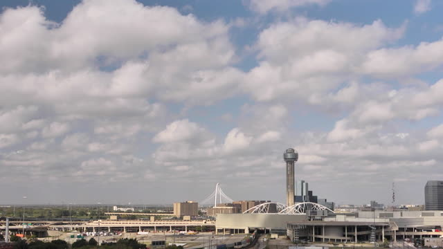 WS T/L View of Reunion Tower and Hunt bridge with clouds / United States