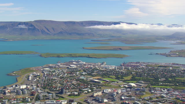 ws aerial view of reykjavik city with bay and clouds over mountain / iceland - reykjavik stock videos and b-roll footage