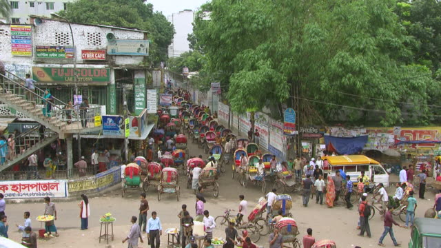 WS HA View of rickshaws lined up in street in busy city center / Dhaka, Bangladesh