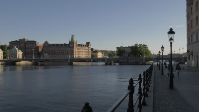 view of riddarholmen church from stromgatan at dusk, stockholm, sweden, scandinavia, europe - circa 13th century stock videos & royalty-free footage