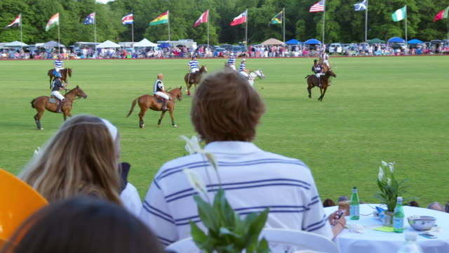 WS PAN SLO MO View of Right spectators in foreground and Newport Polo Competition in background / Portsmouth, Rhode Island, United States