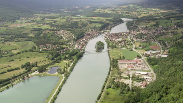 WS AERIAL View of river and bridge with landscape at Seyssel city / Rhone Alpes, France