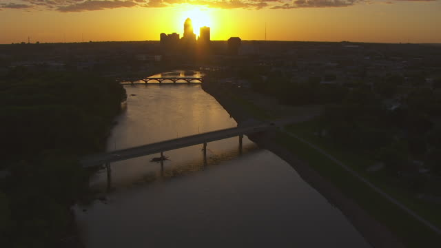 WS TU AERIAL POV View of River at sunset / Des Moines, Iowa, United States