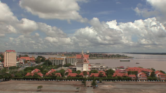 ws view of river leading in and out of phnom penh city / phnom penh, cambodia - phnom penh stock videos and b-roll footage