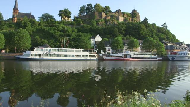 ws view of river saar at saarburg with ship and the castle / saarburg, rhineland palatinate, germany - rhineland palatinate stock videos & royalty-free footage