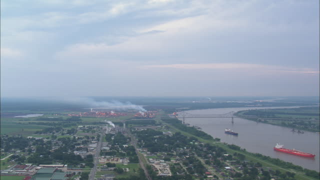 ws aerial view of river with tankers and oil platforms / refineries / texas, united states - oil rig boat stock videos & royalty-free footage