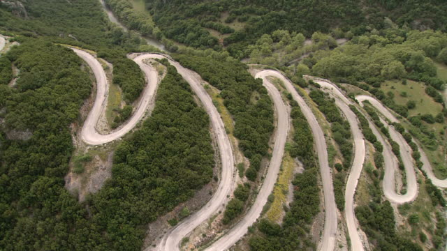 WS AERIAL DS View of road curves leading to top of mountain / Epiros, Thessalia, Greece