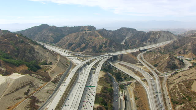 WS AERIAL POV View of road interchange and traffic / Los Angeles, California, United States