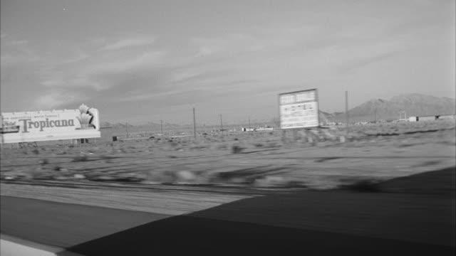 vidéos et rushes de ms pov view of road side city / las vegas, nevada, united states - image en noir et blanc