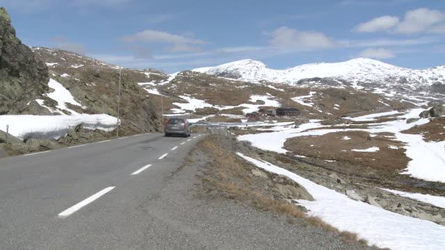 WS View of road through snowy Sognefjellsvegen mountain / Jotunheimen Nationalpark, Sogn og Fjordane, Norway
