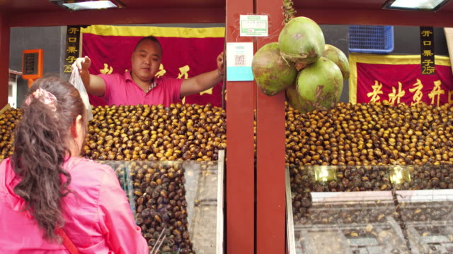 A view of roast chestnuts in famous Wangfujing Snack Street on May 4 2017 in Beijing China Wangfujing is a main business street for tourism next to...