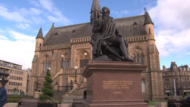 view of robert burns statue in front of mcmanus galleries, a gothic revival-style building which houses a museum and art gallery with a collection of... - lorraine kelly stock videos & royalty-free footage