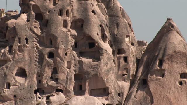ms tu view of rock cut houses / cappadocia, nevsehir province, turkey - cliff dwelling stock videos & royalty-free footage