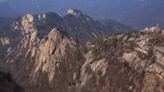 view of rock face (between insubong and bakwundea) in mt. bukhan - rock face stock videos & royalty-free footage