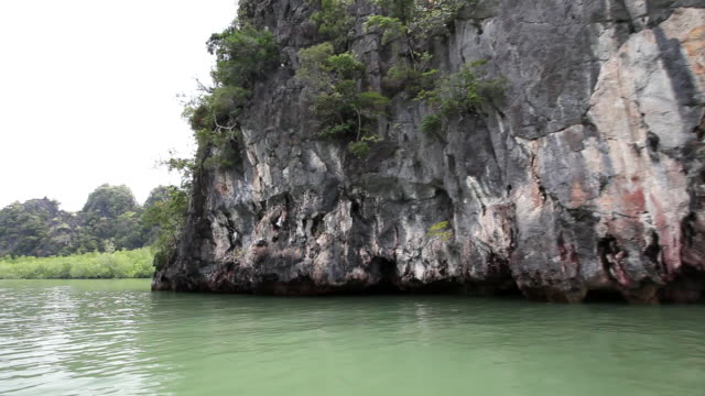 ms pov  view of rock formation in island / phang nga bay, krabi, thailand - phang nga bay stock videos and b-roll footage