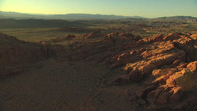 ws aerial view of rock formations in valley of fire with high contrast morning light / nevada, united states - ハイコントラスト点の映像素材/bロール