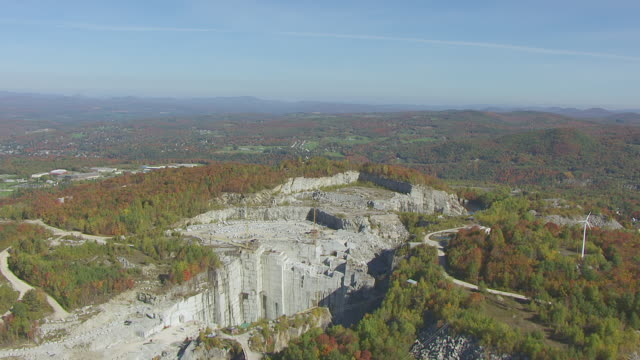 ws aerial pov view of rock of ages corporation with forest area / barre, washington county, vermont, united states - barre stock videos and b-roll footage
