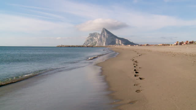 WS View of Rock of Gibraltar in early morning Footprint / Alcaidesa beach, Andalusia, Spain