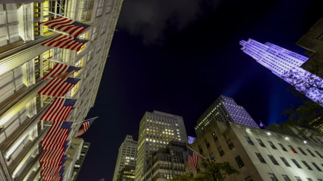 View of Rockefeller Center and Saks Fifth Avenue an American luxury department store / Rockefeller Center is a large complex consisting of 19 high...