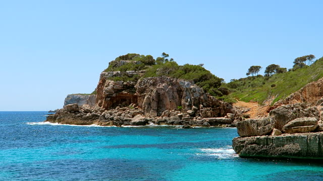 View of rocky coastline of Cala s'Almunia on east coast on Spanish Balearic island of Majorca / Spain