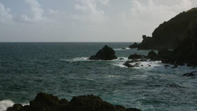 WS TU AERIAL POV View of rocky coastline with cliff / Coral Bay, Saint John, US Virgin Islands, United States