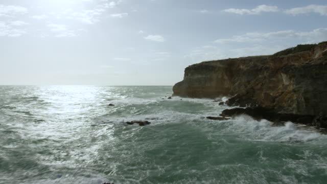 ws aerial pov view of rocky coastline with horizon over in background / cabo rojo, puerto rico, united states - rocky coastline stock videos & royalty-free footage