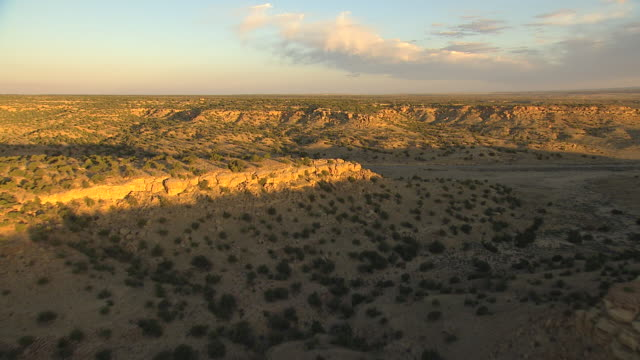 WS AERIAL View of rocky desert with low vegetation in McKinley County during early morning / New Mexico, United States