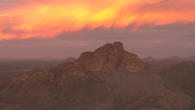 WS AERIAL View of rocky mountains against fiery sky at sunrise / Phoenix, Arizona, United States