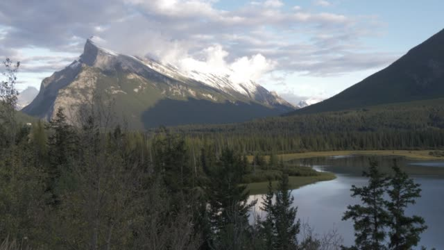 view of rocky mountains near banff, close to trans canada highway 1, banff national park, alberta, canada, north america - alberta stock videos & royalty-free footage