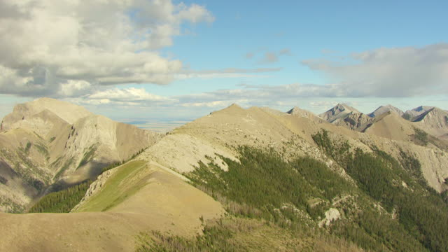 WS AERIAL View of Rocky Mountains near Teton County / Montana, United States