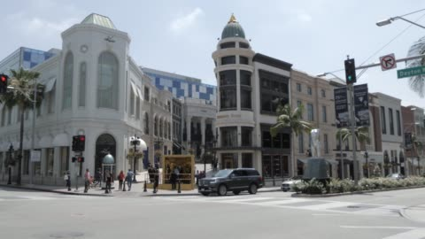 view of rodeo drive from wilshire avenue, beverly hills, los angeles, california, united states of america, north america - beverly hills california stock videos & royalty-free footage