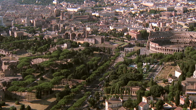 WS AERIAL View of Roman Forum and Coliseum / Rome, Italy