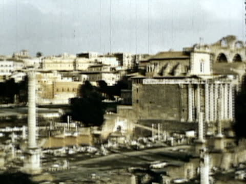 WS PAN TD View of Roman forum with passers-by at University of Rome and St Peter's Cathedral, Vatican City / Rome, Italy / AUDIO
