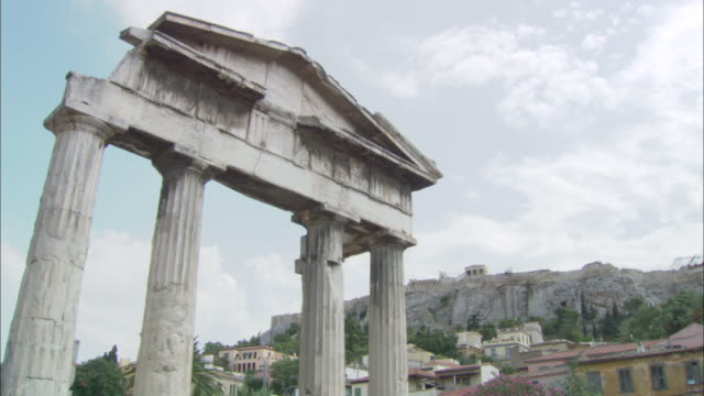 ms view of roman market with acropolis of athens in background / athens, attica, greece - old ruin stock videos & royalty-free footage