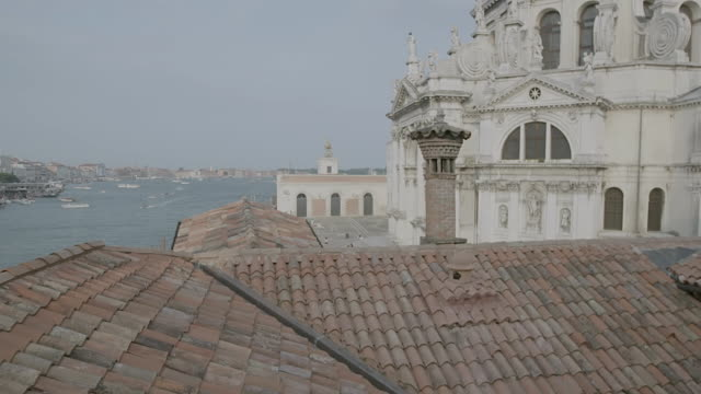 MS TU View of roof tiles, Santa Maria della Salute church in background / Venice, Italy