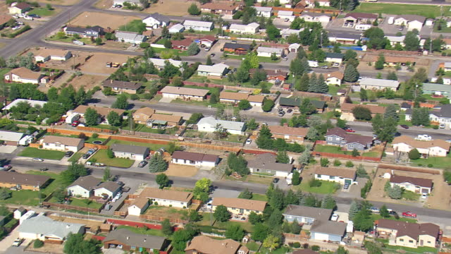 ws aerial zi view of roof tops of houses / wyoming, united states - wyoming stock videos & royalty-free footage