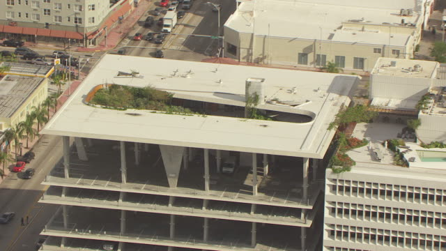 MS AERIAL ZO View of rooftop garden around 1111 Lincoln road parking garage / Miami, Florida, United States