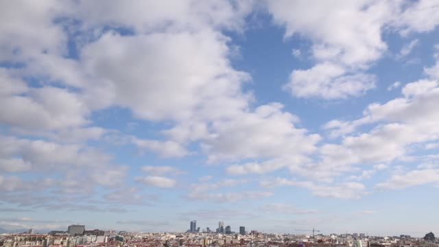 view of rooftops towards puerta de europa from plaza del callao in bright sunshine, madrid, spain, europe - schwenk nach unten stock-videos und b-roll-filmmaterial