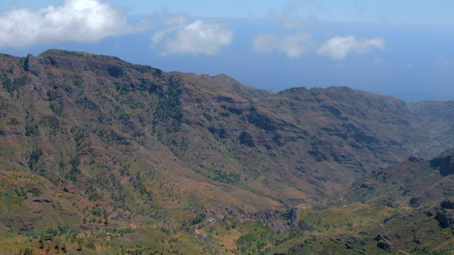 View of Roque de Agando , Valley of Benchijigua and Tenerife on horizon - Parque Nacional de Garajonayon on Canary Islands La Gomera - Spain