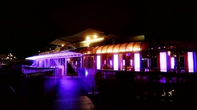 vidéos et rushes de view of rosa bonheur bar at night, in paris france - arts culture et spectacles