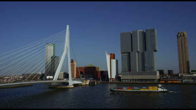 view of rotterdam cityscape architecture and boat traffic - rotterdam stock videos & royalty-free footage