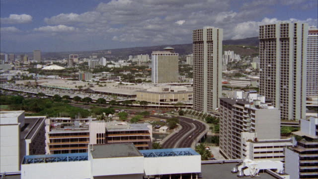 ws zi view of round restaurant on top of building / honolulu - honolulu stock videos and b-roll footage