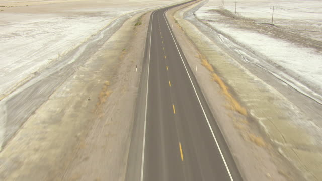 ws aerial tu view of route 50 with no cars in churchill county / nevada, united states - lake bed stock videos & royalty-free footage