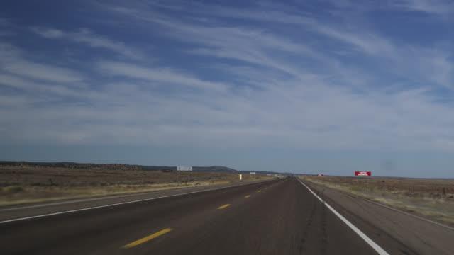 vídeos y material grabado en eventos de stock de ms ts view of route sixty six passing through seligman towards flagstaff / route 66, arizona, usa   - route 66